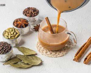 Indian masala chai served with milk, sugar and spices such as cardamon, cinnamon, black pepper, nutmeg, cloves or ginger.